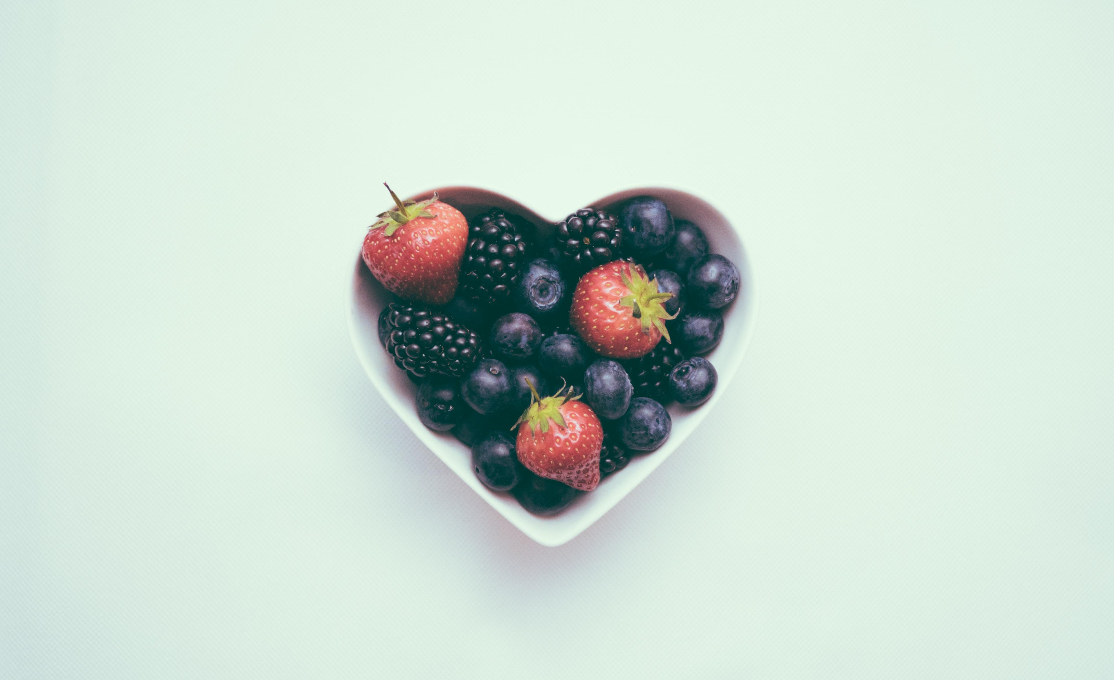 Heart shaped bowl full of berries