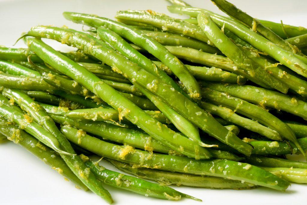 pile of sautéed green beans with lemon zest