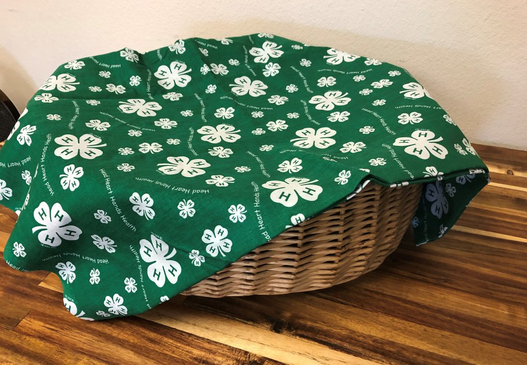 Basket with 4-H fabric cover