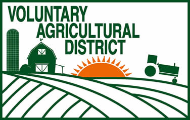Ag District Logo with field, barn, tractor, sun